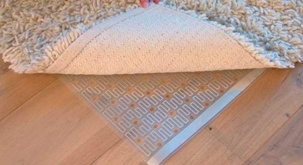 Vloerverwarming onder de vloerkleed
